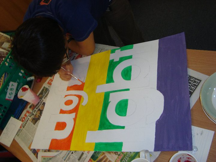 Me painting a placard